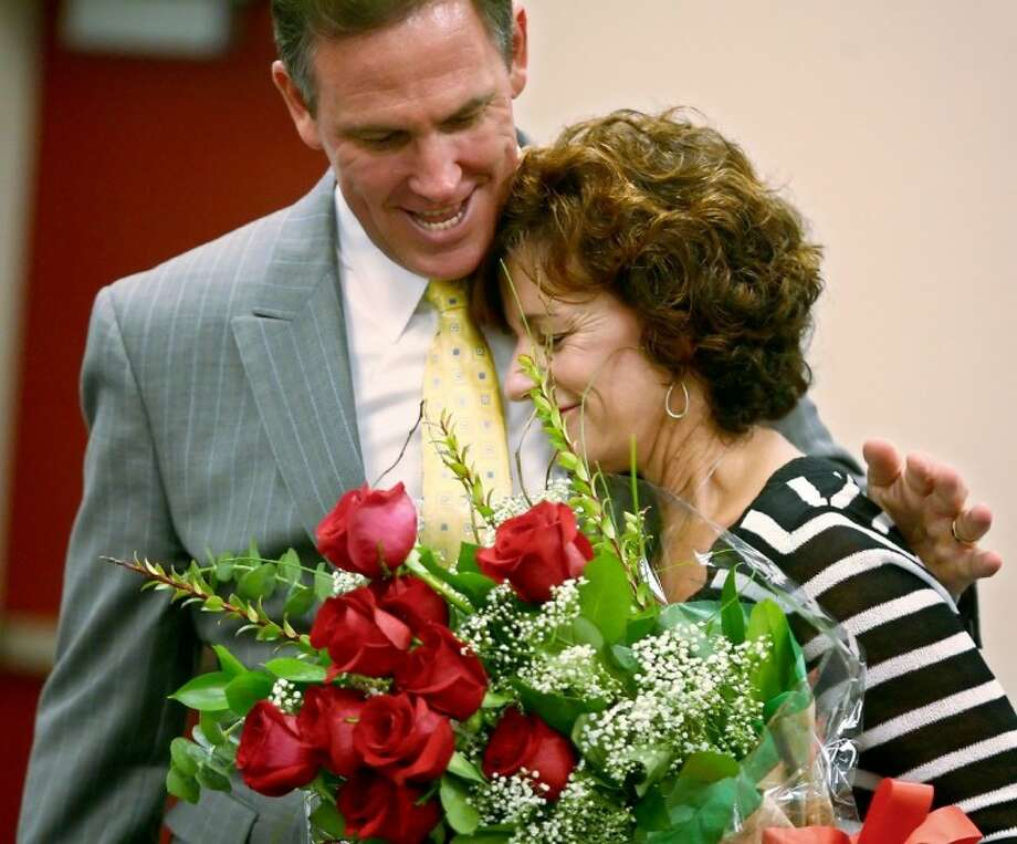 Principal Marlene Lindsay hugs Conroe ISD Superintendent Don Stockton after she received the 2011 Texas National Distinguished Principal award during a surprise ceremony Monday at Galatas Elementary in The Woodlands.