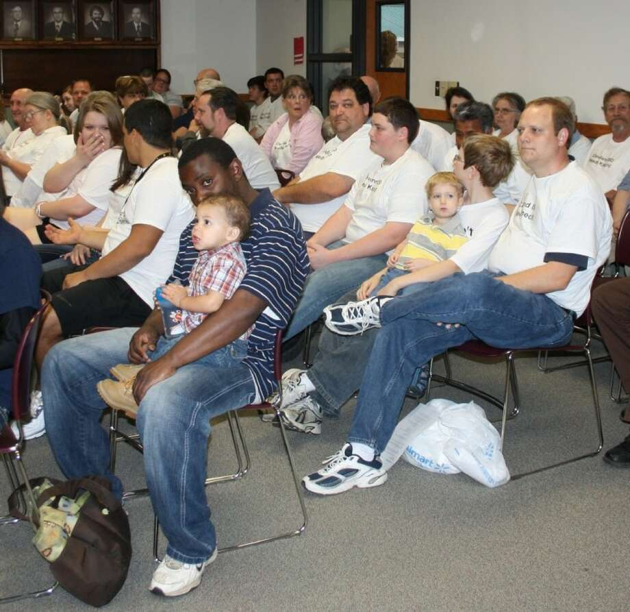 """Dozens of parents, friends and supporters of teacher Dwayne Knecht attended the Cleveland ISD Board of Trustee meeting on March 19. It was standing room only as many of them had white t-shirts with messages on them that read """"Cleveland ISD needs Knecht"""" and """"Don't throw Knecht under the bus!"""" Many of the supporters addressed the school board in support of Knecht and asked that the members reconsider terminating him. Photo: MELECIO FRANCO"""