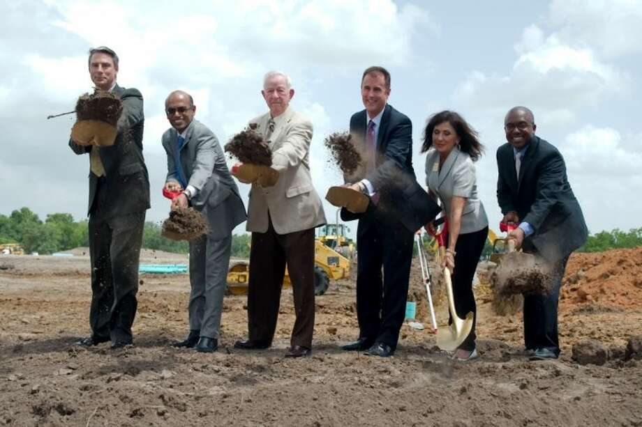 Groundbreaking for the Dover Energy building in Pearland on Tuesday (June 11) included (l to r), Cook Compression President Frank Wierengo, Dover Energy Executive Vice President Soma Somasundaram, Mayor Tom Reid, Waukesha Bearings President Jay Burnette, Pearland Chamber of Commerce President/CEO Carol Artz-Bucek and Pearland Economic Development Corporation Chairman Charles Gooden, Jr. Photo: KIRK SIDES