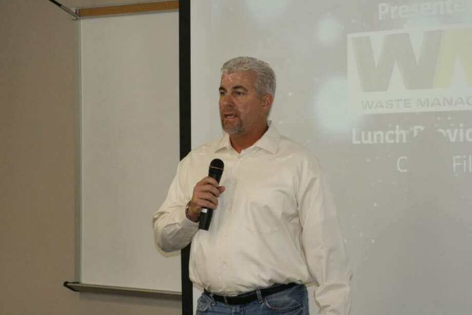 Keith Isbell, owner/operator of Carl's Jr., spoke with residents at the Summer Creek BizCom June 13, 2013 about the new Carl's Jr. set to open in the same shopping center as the H-E-B and Chase Bank.