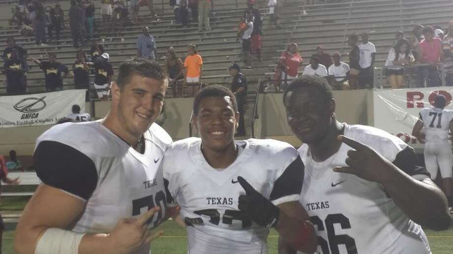Pictured is Langham Creek's Kenneth Thompson and Caleb Hobbs and Cy Falls' Jacobi Hunter at the 2013 Bayou Bowl. Photo: ADAM COLEMAN