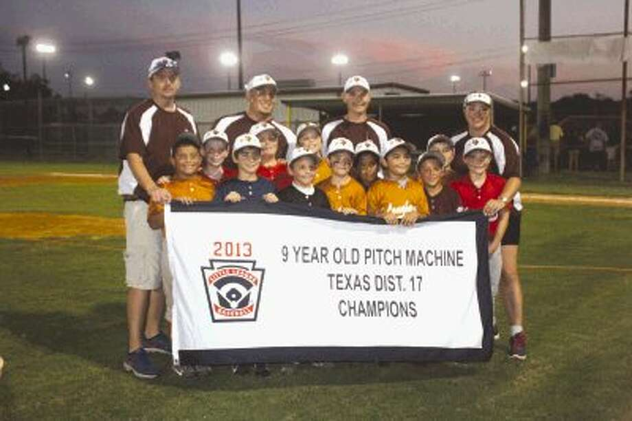 The Deer Park Little League 9-year-old pitching machine all-stars pose with their newly-captured District 17 championship flag Monday night, following their win over Pasadena Red. Photo: Photo By Robert Avery