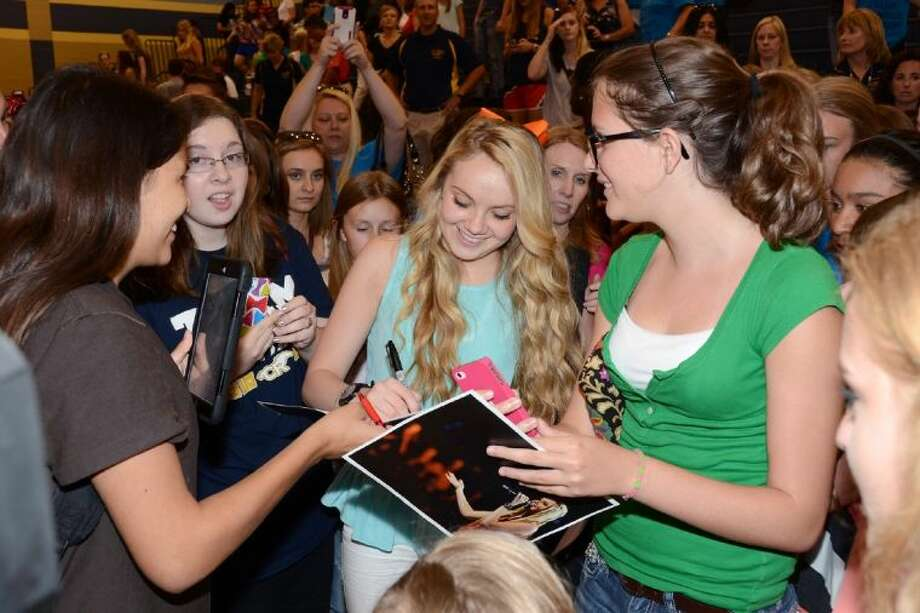 Danielle Bradbery signs autographs for Cypress Ranch students following the pep rally. Submitted