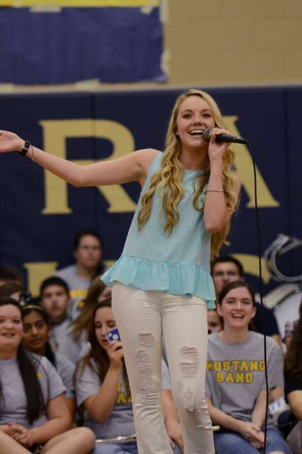 "Danielle Bradbery gives a live performance of her single, ""Mean,"" during the pep rally."