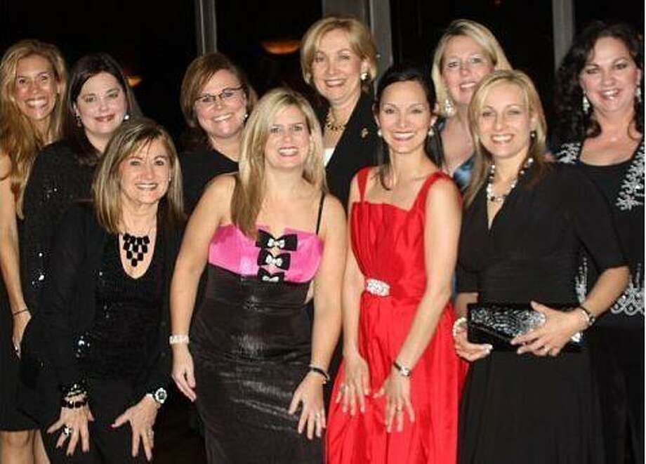Junior League of North Harris and South Montgomery Counties, Inc. celebrated the organization's 20 year history on Feb. 26. Pictured with Debbie Robinson, President of the Association of Junior Leagues International Inc. are Board of Directors members Missy Herndon; Ali May; Carol Lauck; Patty Charles; Shannon Mills; Lauren Temple; Jenni Skipper; Bridget Buck; and Carol Durkee.