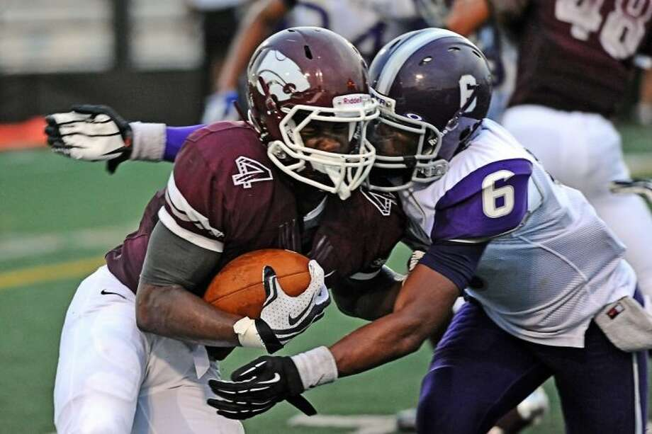 Clear Creek's Kaliq Kokuma (left) and the rest of the Wildcats are restricted by a contact rule for practices which head coach Darrell Warden says won't impact his team. Photo: KIRK SIDES