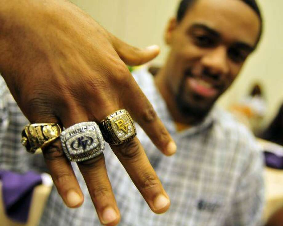 Prairie View cornerback Jason Fobbs from Shreveport, La., received his championship ring and immediately placed it on his finger between his team rings in track for indoor and outdoor SWAC track. The football team received their SWAC championship rings Tuesday during a ceremony at the university.