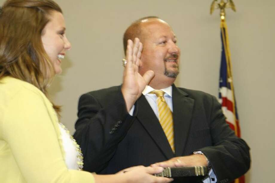 Humble ISD board member Robert Sitton with his wife, Jen Sitton, was sworn in after winning re-election for Humble ISD board of trustees Position 1.