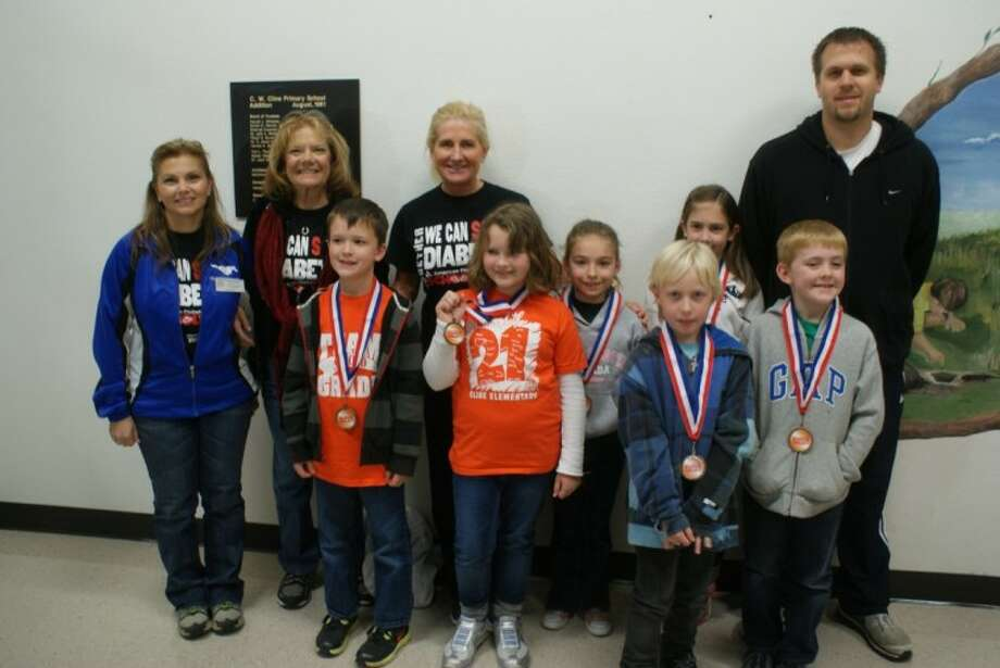 Cline top fundraisers for the School Walk for Diabetes include Top fundraiser for three consecutive years Emma Ryan, Mackenzie Davidson, Nicolas Darrow, Casey Bridwell and Jake Mayo. They are joined by adults Sara Ruiz, Judy Shetler, Mary Baumann Nate Holtvluwer. Photo: Courtesy Friendswood ISD