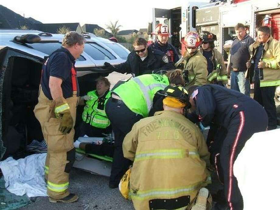Friendswood Fire and EMS workers load an elderly female onto stretcher for transport on Life Flight Friday morning.