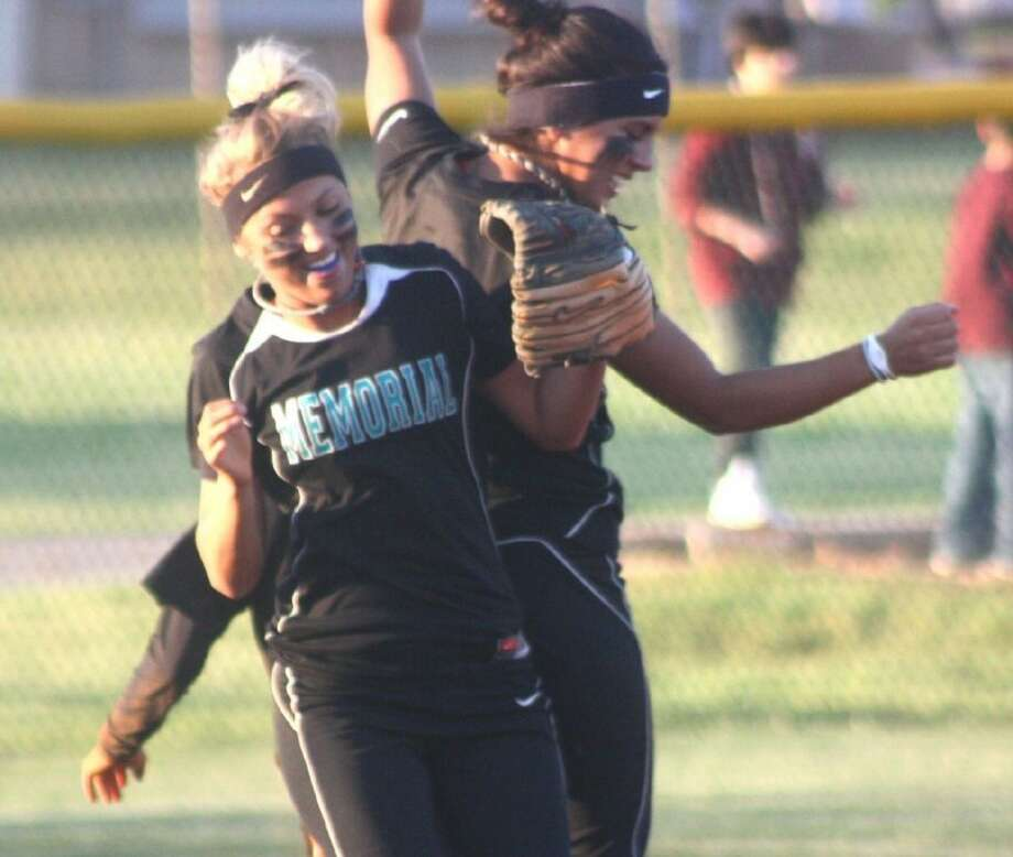 Pasadena Memorial second baseman Haley Franklin and shortstop Natali Duron celebrate a double play that got the Lady Mavs out of a serious first-inning jam Friday night. For more on the key 22-5A softball contest, see What's Happening. Photo: Robert Avery