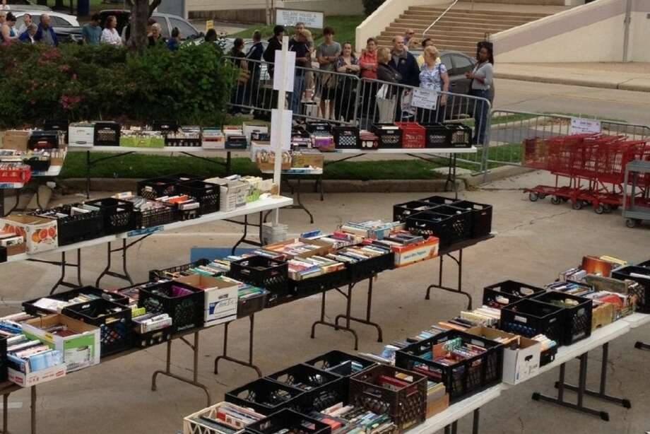 Anxious book buyers line up in advance of the 9 a.m. opening of the Friends of Bellaire Library's semi-annual used book sale Saturday. The sale runs through 4 p.m. in the library parking lot, 5111 Jessamine St.