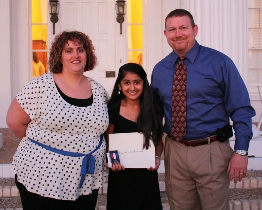 Cleveland Middle School student Anjali Dalwadi won the Libertad Chapter Daughters of the American Revolution Essay Contest. She is supported by her teacher, DeWanda Dubbin, and principal, Reese Briggs, at the awards ceremony. Photo: STACEY GATLIN