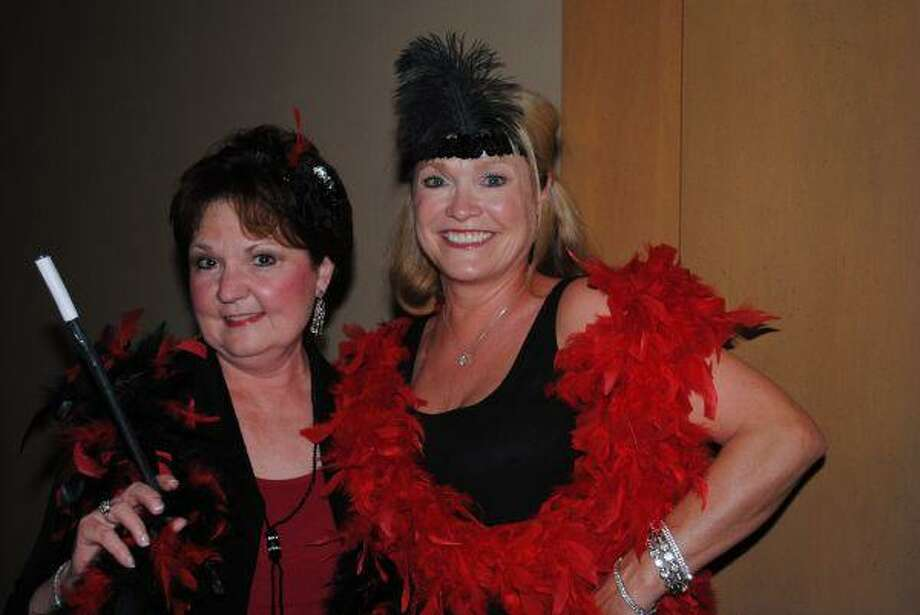 Are we having fun yet? That's what Renee Wilson, left, and Becky Reitz said as they got ready to party down at the Assistance League Gala Saturday night at South Shore Harbour Resort.