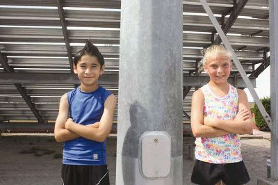 Two of the youngsters who will be representing Pasadena at this Saturday's Hershey's state championship track meet in Round Rock will be Hans Leza (left) and Paige Harbuck. Both will be competing against kids from across the state in the 400-meter run for the 9 and 10-year-old division. Photo: Photo By Robert Avery
