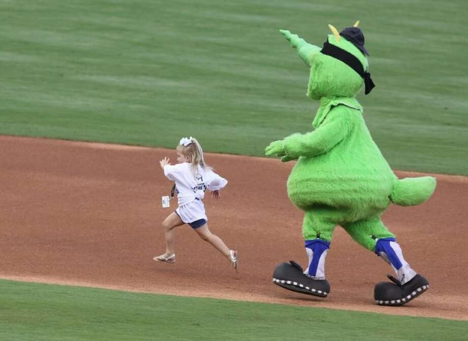 Sugar Land Skeeters' mascot Mo tries to beat Paylie Ashcraft on her birthday as she runs the bases June 12 at Constellation Field in Sugar Land. The Skeeters defeated Camden 3-2. Photo: Alan Warren