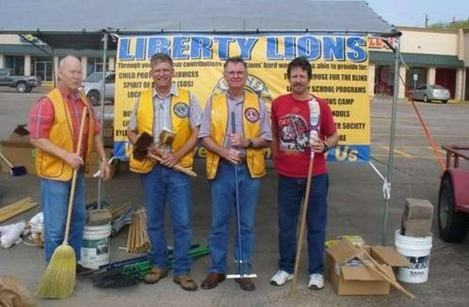 The Liberty Lions Club will hold its annual broom and mop sale on April 2 at the Thrif-Tee Food Center parking lot on Main Street in Liberty. Pictured at the 2011 broom and mop sale are Lions Walter Shoaf, Leon Blackwelder, Paul Newton and Arnold Zamazal. Photo: Submitted Photo
