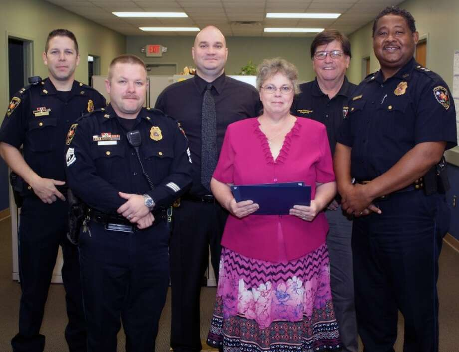 Mary Blake was selected as the Volunteer of the Year by the Cleveland Police Department. Blake purchased stuffed animals and donated them to the department so that officers could give them to children when they responded to incidents involving children. Blake said that the toys offer immediate comfort to a child at a crime scene. Shown from left to right are Patrol Captain Scott Felts, Sgt. Paul Lowrey, Sgt. Investigator John Shaver, Mary Blake, Capt. James Primeaux and Assistant Chief Darrel Broussard. Photo: Submitted Photo