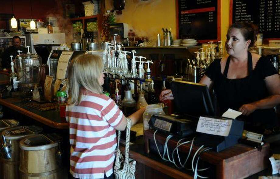 New Brewed Awakenings owner Becca Hance takes an order from one of her many loyal customers.