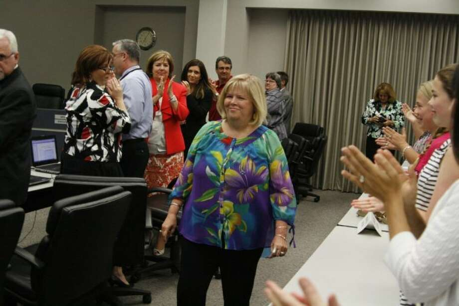 Dr. Bonnie Longnion received a standing ovation when she was recognized at the Humble ISD school board meeting June 11, 2013.