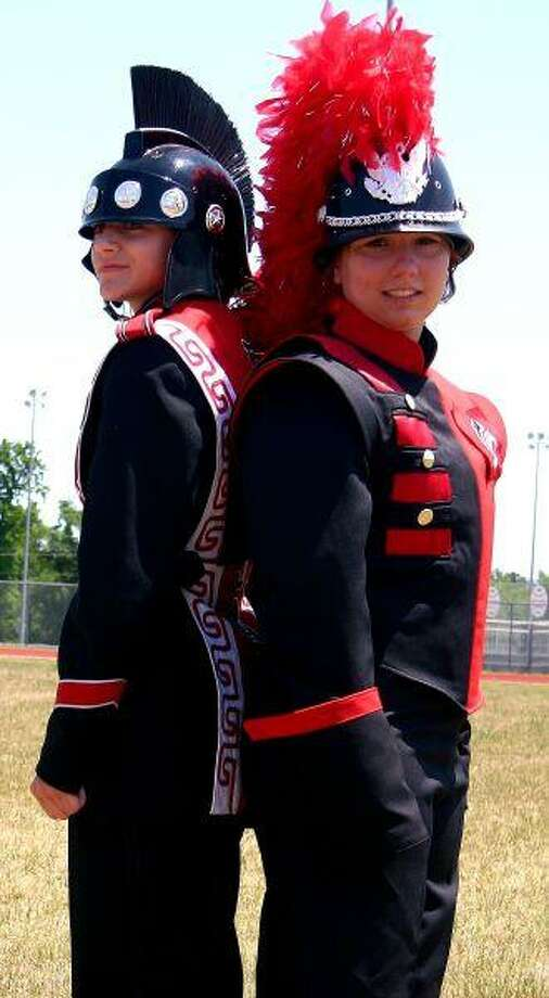 Steffanie Meekins (left) models the old Coldspring-Oakhurst High School Trojan Band uniform and Marienke Hauss (right) models the new uniform. The Coldspring-Oakhurst Consolidated ISD board of trustees voted to approve the purchase of the new uniforms at their Tuesday, April 27, meeting.