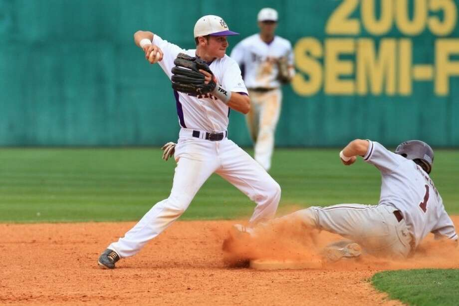 Montgomery second baseman Nate Van Dyke records a force out on Magnolia's Ty Rowden at second base on Saturday at Montgomery High School.