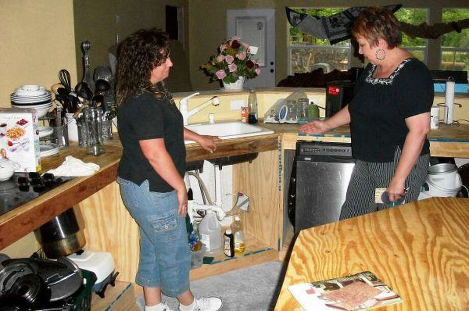 Home Depot Manager Angela Thorndyke and Hope Cancer Retreat owner Jenny Jackson looked at how much work needs to be done to finish the kitchen.