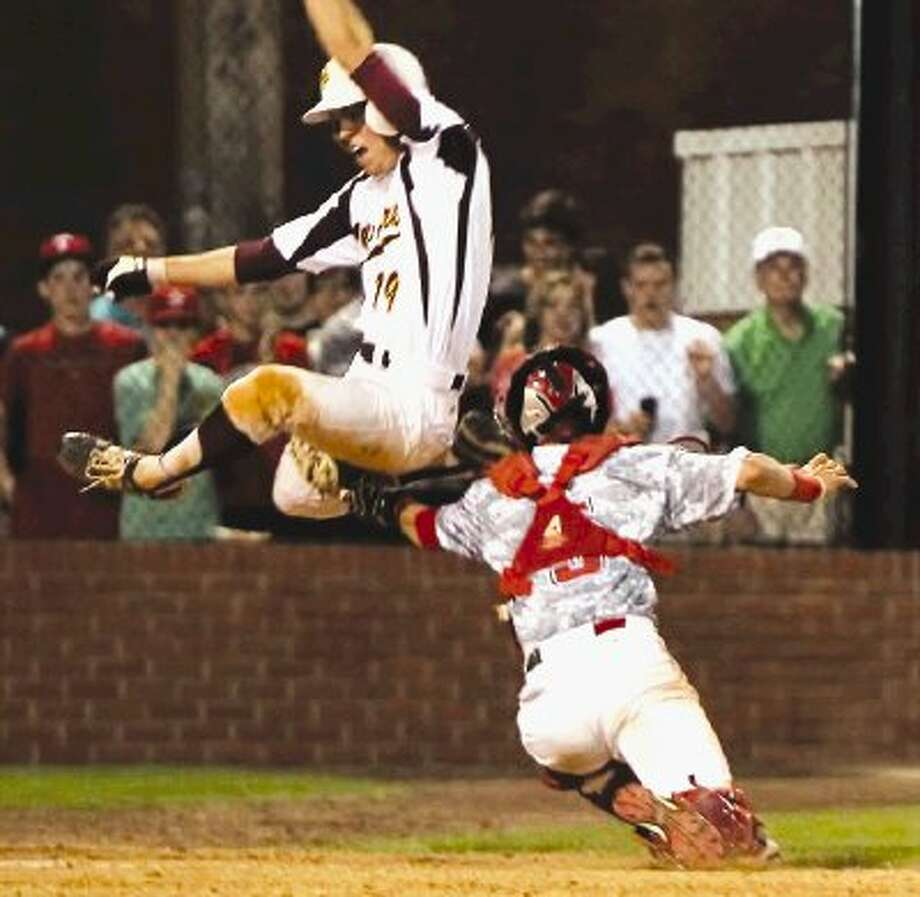 Deer Park's Bailey Darden leaps up in an attempt to avoid the tag, but he still gets erased at home plate during a dramatic moment of the contest last Saturday night. Photo: Carlyle Henry / 2012 Premier Sports Photos
