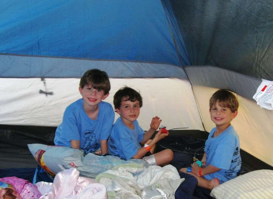 With all the activities going on outside, a number of youngsters still enjoyed the experience of hanging out in their tents. Photo: CHARLOTTE AGUILAR