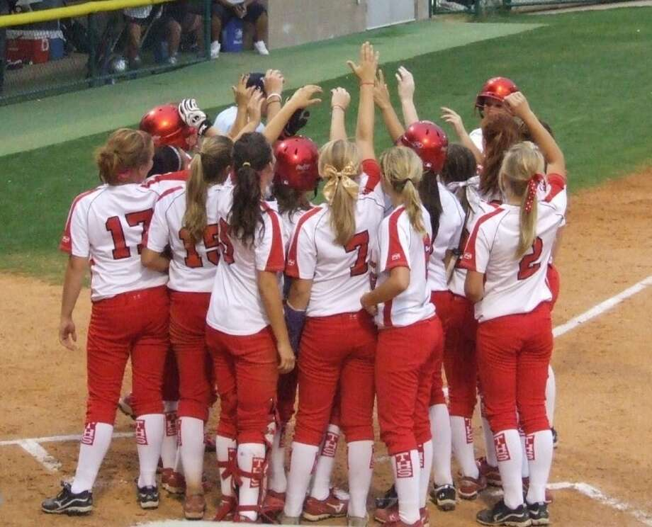 The Tomball softball team celebrates a two-run home run by Alyssa Bass during an 11-1 victory May 20 at Sam Houston State University. The Lady Cougars swept Bryan to reach the Region II-5A championship series.