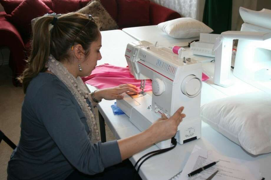 Photo by REBECCA BENNETT/The RancherMackie Morris, a student in Just Sew's sewing basics class, learns how to use her machine to create seams for a pillowcase.