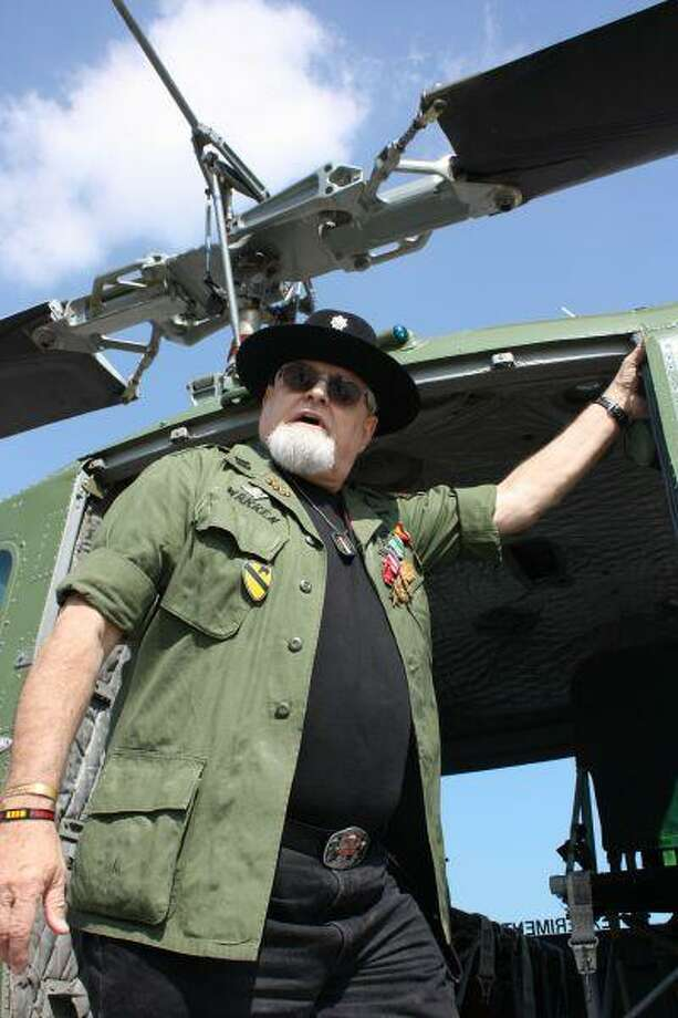 Mike Mastrango, retired LTC and Vietnam War veteran inspects a restored Huey UH helicopter at the Wings of Freedom Tour.