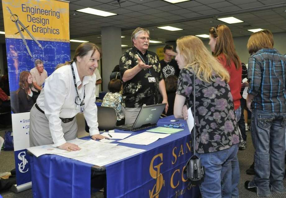 San Jacinto College engineering design graphics professors Mary Ann Blake (left) and Daryl Morse (right) discuss program information at last year's South Campus open house event. Photo credit: Andrea Vasquez, San Jacinto College marketing department.