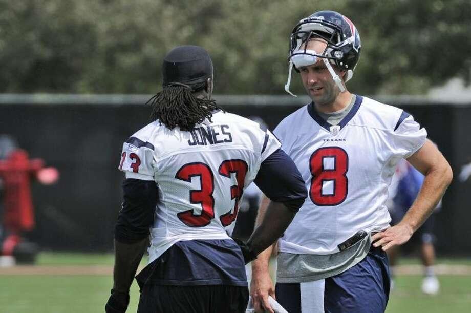 Texans quarterback Matt Schaub, right, converses with running back Greg Jones during the team's workouts on Monday.