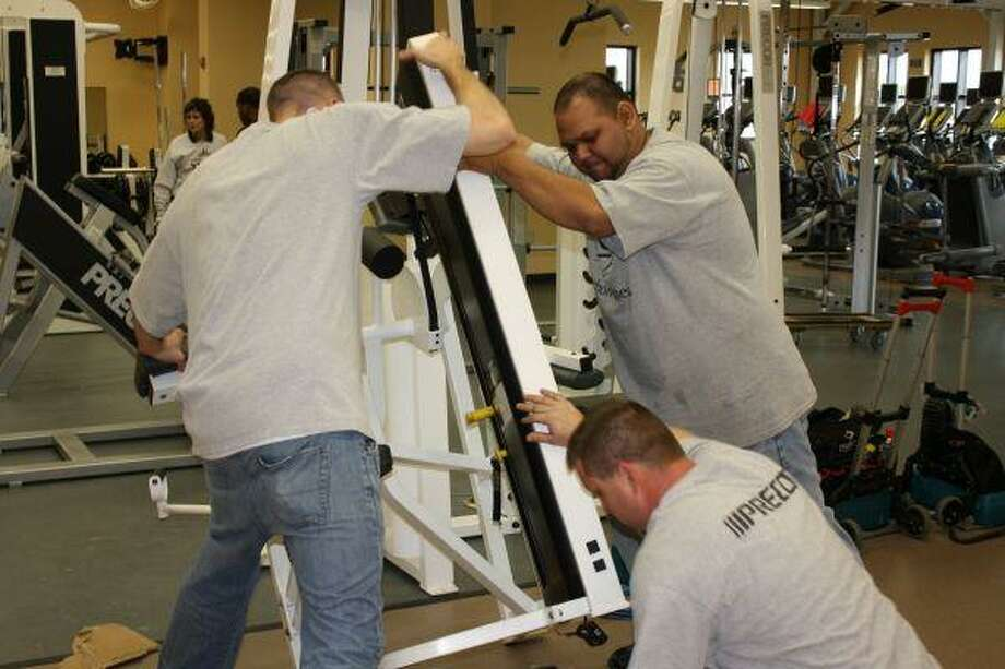 During last week's finishing touches in the Wellness Center, workers got a workout moving around the equipment.