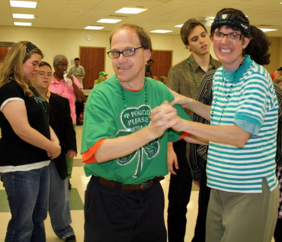 """More than 100 guests attended the Pearland Parks and Recreation's """"No Limits"""" Adaptive Recreation program St. Patrick's Dance for individuals with developmental disabilities held Friday March 16. Photo: Submitted Photo"""