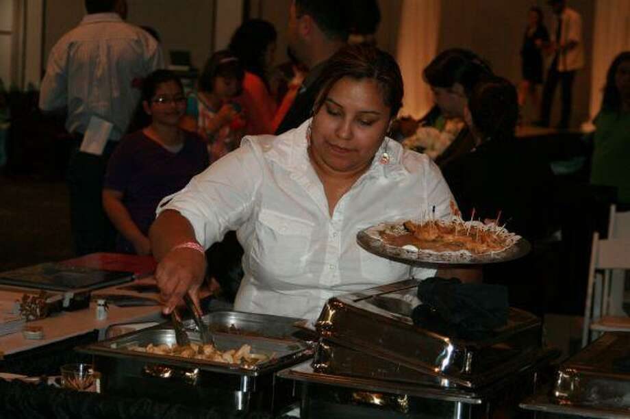 Flores Catering was a vendor at the annual Lake Houston Bridal Show where it showed off its food and place settings for guests at the event March 28.