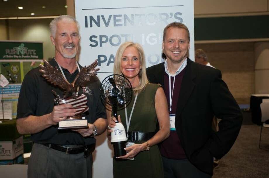 """Rick and Cynthia Wark pose with Russell Williams after being awarded the """"Pinnacle Award-Best in Show"""" for the Personal Golf Fan at the Inventor's Spotlight Awards during the 60th PGA Merchandise Show Jan. 24 at The Orange County Convention Center in Orlando, Fla. Photo: Montana Pritchard"""