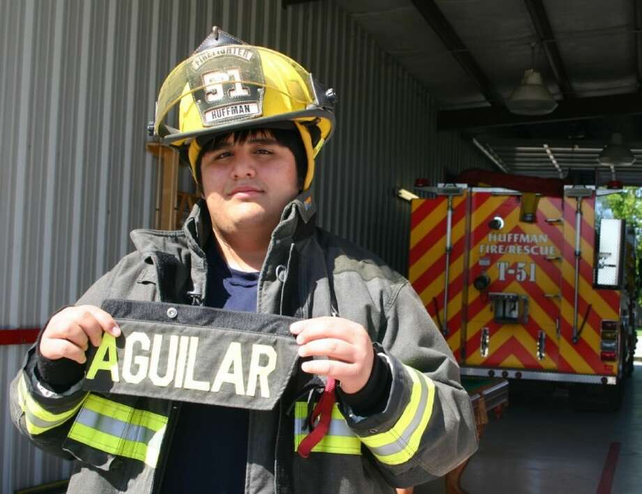 Chris Aguilar put on the bunker gear at the Huffman Volunteer Fire Department station, where Chris hopes to volunteer again after doctors give him the go-ahead. A Hargrave High School EKG conducted before the school year showed the family that Chris, a sophomore who has played on the football team, had a heart abnormality. He underwent surgery March 19 to correct it. Photo: STEPHEN THOMAS