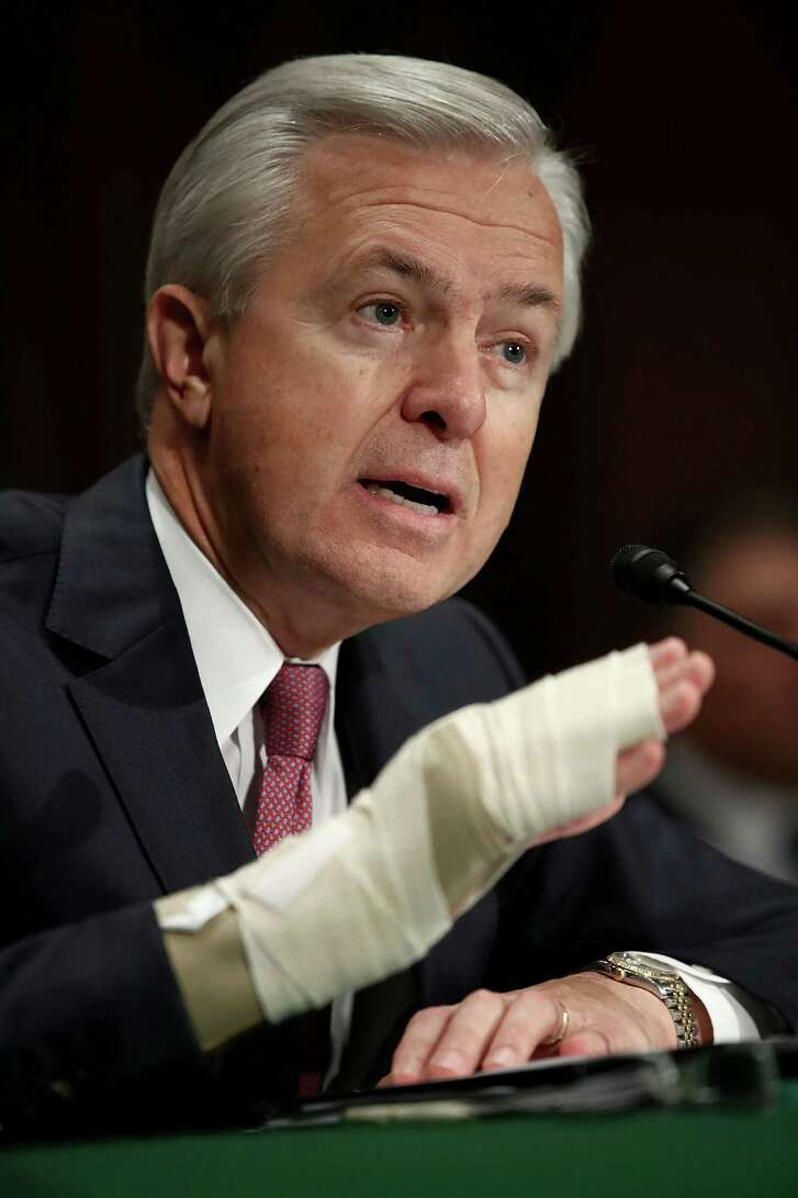 John Stumpf, chairman and CEO of the Wells Fargo & Company, testifies before the Senate Banking, Housing and Urban Affairs Committee September 20, 2016 in Washington, DC. Wells Fargo's board of directors stripped Stumpf and former retail banking head Carrie Tolstedt of tens of millions of dollars in pay.