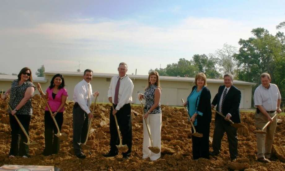 Breaking ground March 27 where Security State Bank will build a permanent structure for its Liberty Banking Center are, from left, Liberty Banking Center Assistant Branch Manager Debbie Adams, Liberty Banking Center Assistant Vice President Maria Trevizo, Security State Bank President and CEO Gary VanDeventer, Anahuac Banking Center President Clyde Mordica, Liberty Banking Center President Bessie Conn, Dayton Banking Center President Arlene Langham, Advisory Director and Liberty City Councilman Frank Jordan, and Advisory Director and State Rep. John Otto. Photo: STEPHEN THOMAS