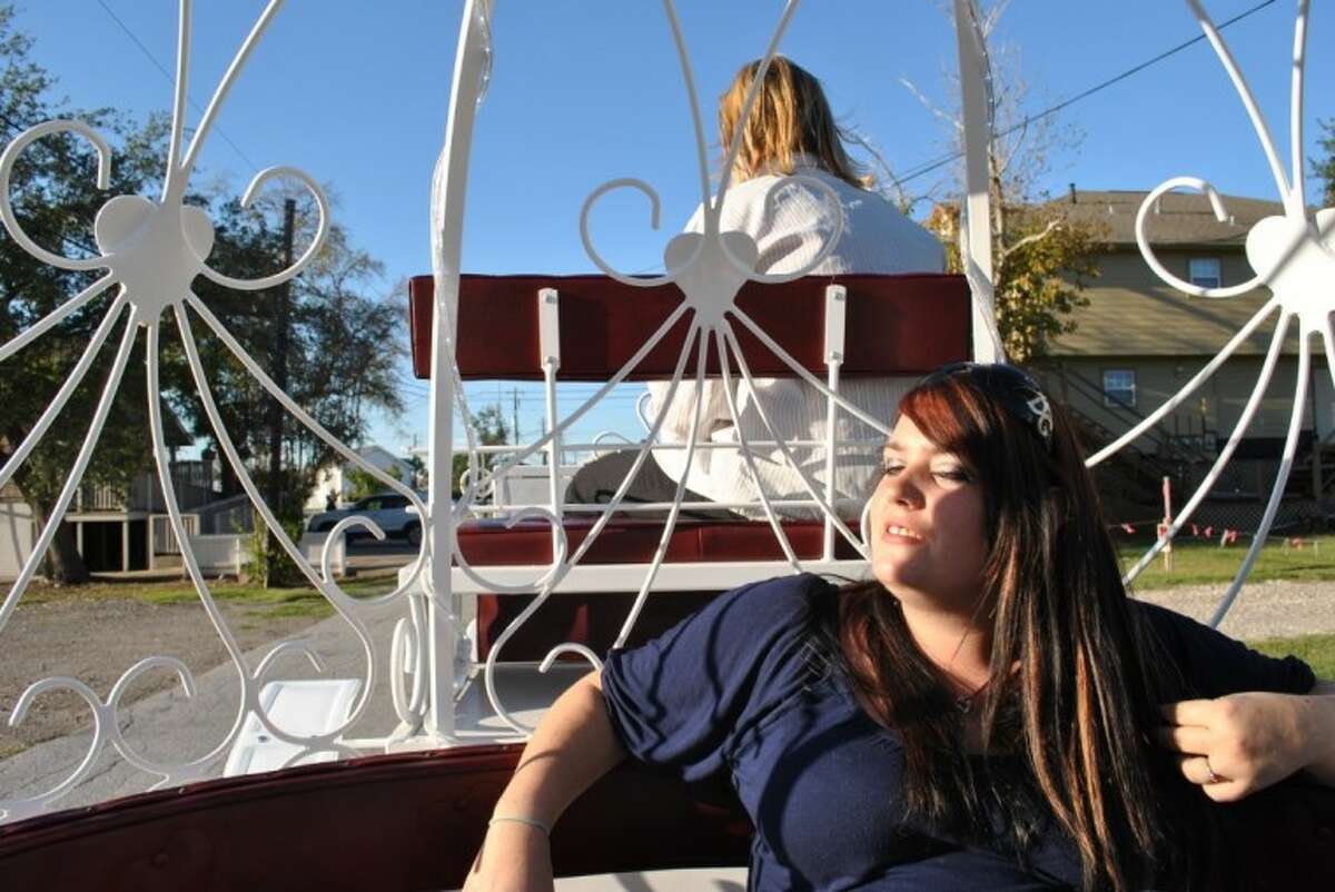 Kemah Carriages Manager Chanci Mowry enjoys a ride in one of the carriages.