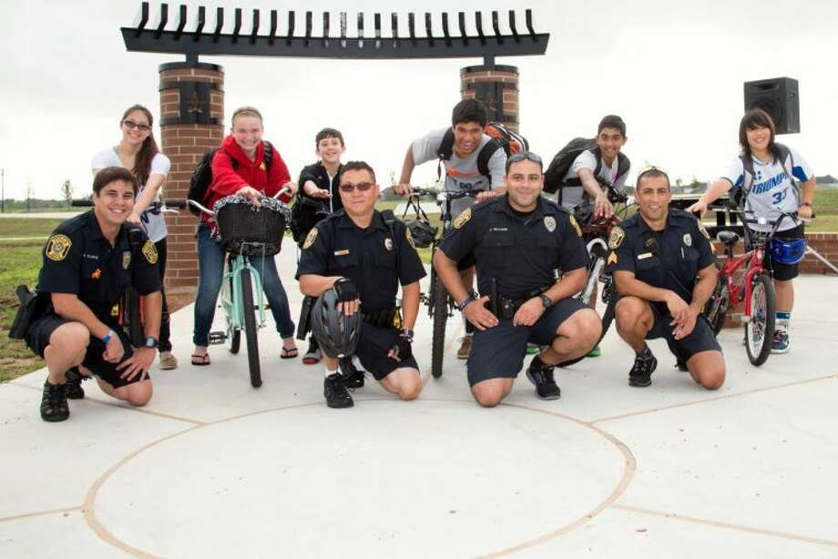 Left to right: Chloe Gallegos, Bailey Rivenes, Jake Parker, Vivek Sinha, Shiv Chopra and Kelly Eng with Sugar Land Police Officers