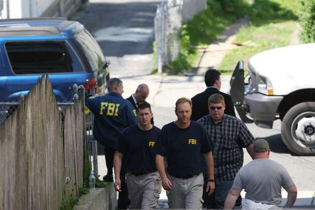 BRIDGEPORT, CT - MAY 4:   FBI personnel conduct an evidence search of a house where Faisal Shahzad lived in connection with the botched Times Square bombing May 4, 2010 in Bridgeport, Connecticut. Shahzad, a suspect in this past weekend's failed car bomb plot in Times Square was taken into custody late Monday by FBI agents and New York Police Department detectives while trying to leave the country at John F. Kennedy Airport.  (Photo by Daniel Barry/Getty Images) Photo: Daniel Barry, Getty Images / 2010 Getty Images