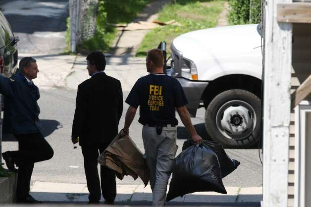 BRIDGEPORT, CT - MAY 4:   FBI personnel remove evidence during a search of a house where Faisal Shahzad allegedly lived, in connection with the botched Times Square bombing May 4, 2010 in Bridgeport, Connecticut. Shahzad, a suspect in this past weekend's failed car bomb plot in Times Square was taken into custody late Monday by FBI agents and New York Police Department detectives while trying to leave the country at John F. Kennedy Airport.  (Photo by Daniel Barry/Getty Images) Photo: Daniel Barry, Getty Images / 2010 Getty Images