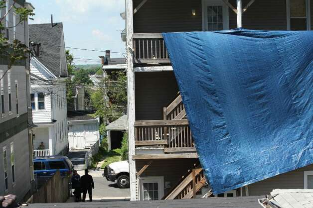 BRIDGEPORT, CT - MAY 4:  FBI personnel stand in the drive as a tarp covers the back of a residence where Faisal Shahzad allegedly lived, in connection with the botched Times Square bombing May 4, 2010 in Bridgeport, Connecticut. Shahzad, a suspect in this past weekend's failed car bomb plot in Times Square was taken into custody late Monday by FBI agents and New York Police Department detectives while trying to leave the country at John F. Kennedy Airport.  (Photo by Daniel Barry/Getty Images) Photo: Daniel Barry, Getty Images / 2010 Getty Images