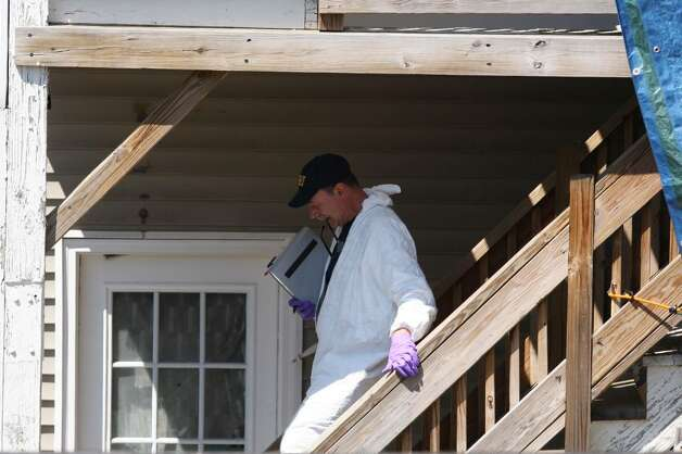 BRIDGEPORT, CT - MAY 4:   FBI personnel conduct an evidence search of a house where Faisal Shahzad allegedly lived, in connection with the botched Times Square bombing May 4, 2010 in Bridgeport, Connecticut. Shahzad, a suspect in this past weekend's failed car bomb plot in Times Square was taken into custody late Monday by FBI agents and New York Police Department detectives while trying to leave the country at John F. Kennedy Airport.  (Photo by Daniel Barry/Getty Images) Photo: Daniel Barry, Getty Images / 2010 Getty Images