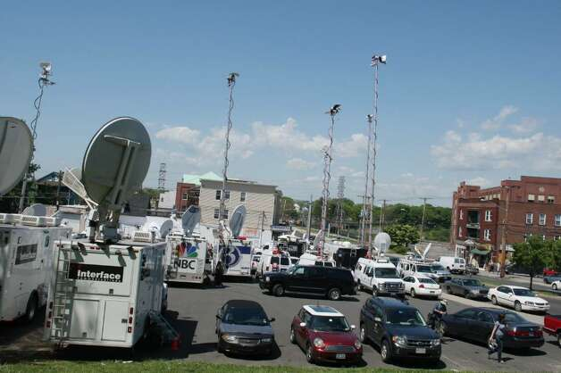 BRIDGEPORT, CT - MAY 4:   Media trucks gather near where FBI personnel conduct an evidence search of a house where Faisal Shahzad allegedly lived, in connection with the botched Times Square bombing May 4, 2010 in Bridgeport, Connecticut. Shahzad, a suspect in this past weekend's failed car bomb plot in Times Square was taken into custody late Monday by FBI agents and New York Police Department detectives while trying to leave the country at John F. Kennedy Airport.  (Photo by Daniel Barry/Getty Images) Photo: Daniel Barry, Getty Images / 2010 Getty Images