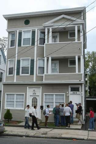 BRIDGEPORT, CT - MAY 4:   Members of the media outside a house where Faisal Shahzad lived May 4, 2010 in Bridgeport, Connecticut. Shahzad, a suspect in this past weekends failed bomb plot in Times Square was taken into custody late Monday by FBI agents and New York Police Department detectives while trying to leave the country.  (Photo by Daniel Barry/Getty Images) Photo: Daniel Barry, Getty Images / 2010 Getty Images