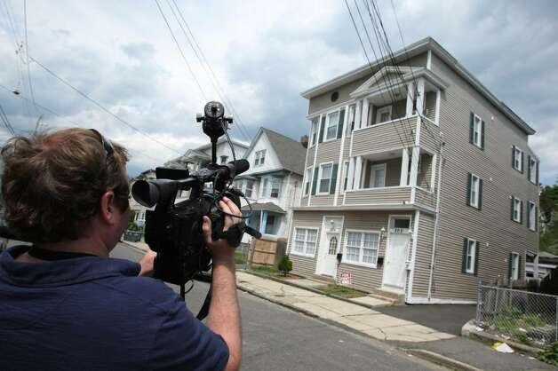 BRIDGEPORT, CT - MAY 4: A member of the media films the exterior of a house where Faisal Shahzad lived May 4, 2010 in Bridgeport, Connecticut. Shahzad, a suspect in this past weekend's failed car bomb plot in Times Square was taken into custody late Monday by FBI agents and New York Police Department detectives while trying to leave the country at John F. Kennedy Airport. (Photo by Daniel Barry/Getty Images) Photo: Daniel Barry, Getty Images / 2010 Getty Images